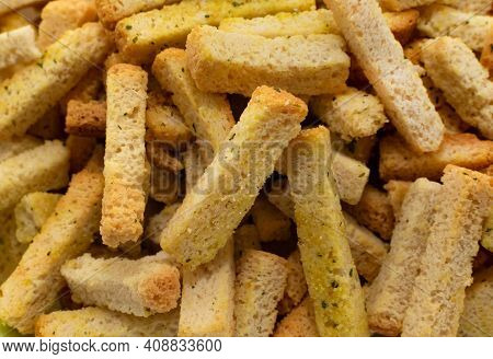 Breadcrumbs In Cubes And Sticks Close-up. Bread. Breadcrumbs For Beer. Croutons
