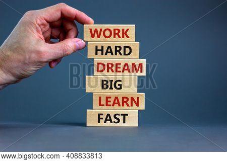 Work Hard Dream Big Symbol. Words Work Hard Dream Big Learn Fast On Wooden Blocks On A Beautiful Gre