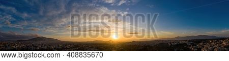 Sunset Over Athens, Greece. Aerial Drone Panoramic View From Penteli Mount.