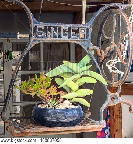 Kfar Kama, Israel- April 11, 2019: Flower Stand Made From Old Singer Sewing Machine With Foot Pedal