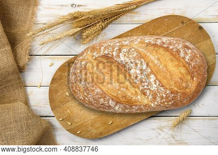 Rustic Baking Template - Top View Of A Fresh Baked Bread On A Wooden Vintage Cutting Board With Cere