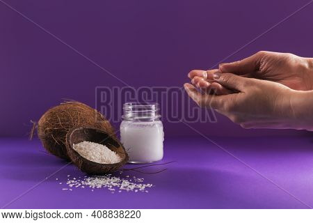 Composition With Natural Organic Coconut Oil Cosmetic Body Cream On Purple Color Background. Woman's