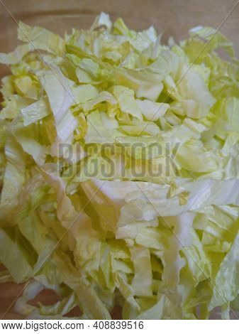 Peking Cabbage, Finely Chopped In A Glass Dish. High Quality Photo