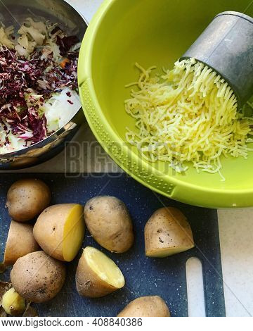 Cooked Potatoes On A Board, Potatoes Squeezed Through A Press, Ingredients Prepared For Cooking