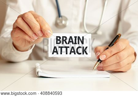 Brain Attack Card In Hands Of Medical Doctor. Doctor's Hands A Sheet Of Paper With Text Brain Attack