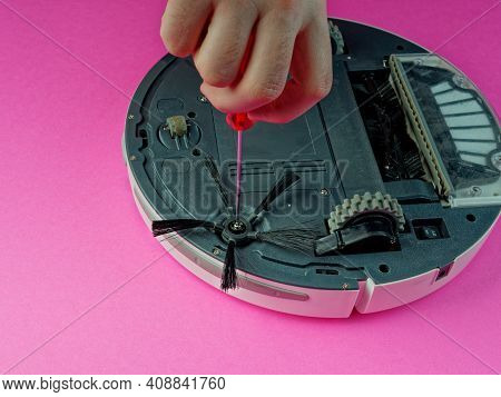 The Robot Vacuum Cleaner Is Disassembled, The Vacuum Cleaner Is Being Cleaned And Disassembled