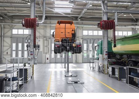 Truck At The Service Center. Servicing And Repairing Trucks In A Large Garage, Diagnostics. Logistic