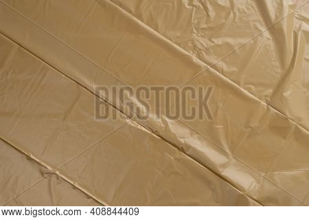 Folded Plastic Wrinkled Recycled Garbage Bag With Wrinkles. Abstract Background With Parallel Geomet