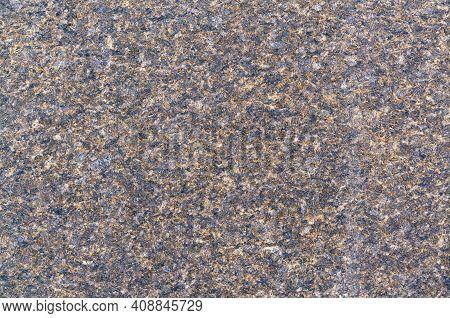 Natural Stone Brown Granite Background. Granite Texture. A Rock
