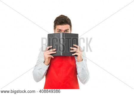 What To Cook. Man Hipster Cook Apron Reading Book About Culinary. No Idea How Cook Food. Culinary Bo