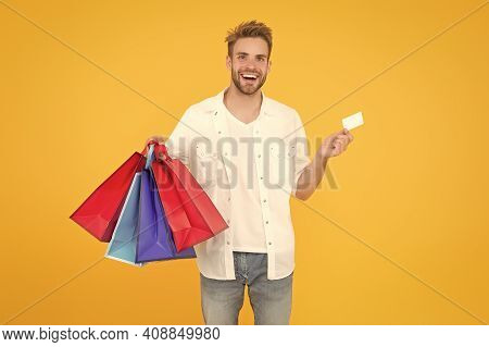 Bachelors Day. Consumerism Concept. Cheerful Client Customer Consumer Smiling With Fashion Purchases