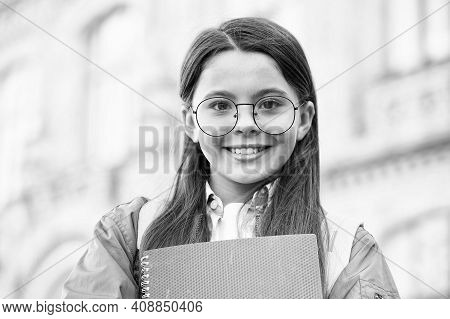 Feeling Happy About Doing Homework. Happy Child Back To School. Little Kid Hold Books. Homework Assi