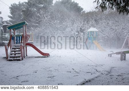 Winter Morning Snow Covered Childrens Playground In The Athens City, Greece, 15th Of February 2021.