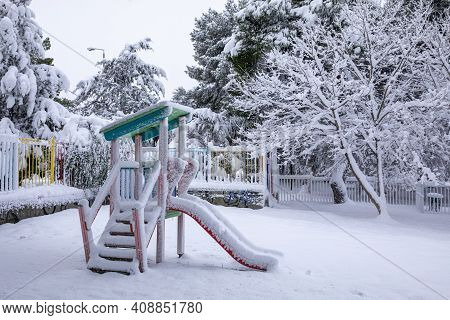 Winter Morning Snow Covered Childrens Playground In The Athens City, Greece, 16th Of February 2021.