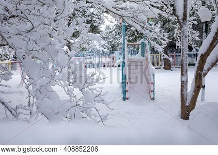 Winter Morning Snow Covered Playground In The Athens City, Greece, 16th Of February 2021.