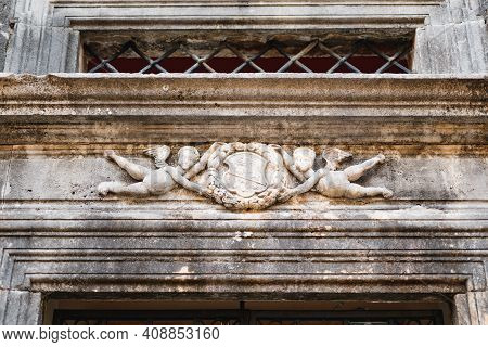 The Palaces Of Kotor With A Bas-relief In The Form Of Two Babies With Wings.