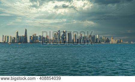 Doha, Qatar - February 2019: Doha Qatar Skyline Cityscape With Skyscrapers Under Dramatic Clouds