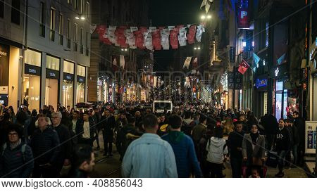 Istanbul, Turkey - November 2019: Crowd People Walking In Istiklal Street In Taksim. Turkish People