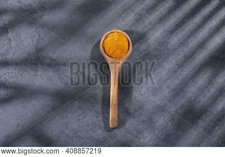 Curcuma Longa - Turmeric Powder In Wooden Spoon