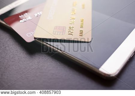 Credit Card On Smartphone. Shopping Online Without Cash. Planing Earn Money Investment And Saving Mo