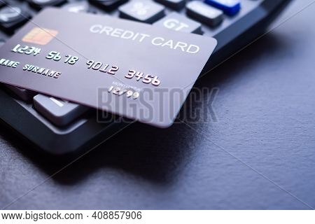 Credit Card On Calculator. Shopping Online Without Cash. Planing Earn Money Investment And Saving Mo