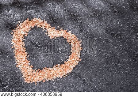 Himalayan Pink Salt Crystals On Black Background, Space For Text