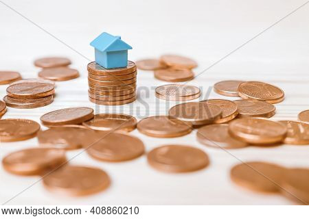 Toy Blue Model House Mortgage Rates Income Real Estate Rental Home Invest Money Loan Property. One E