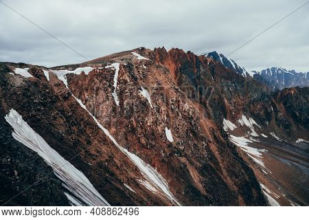 Surreal Aerial View To Giant Mountain With Sharp Stones On Top. Atmospheric Landscape With High Poin