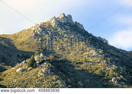 Mountain Peak With Rocky Crags Covered With Chaparral Plants Taken At A Chaparral Woodland In The Ru