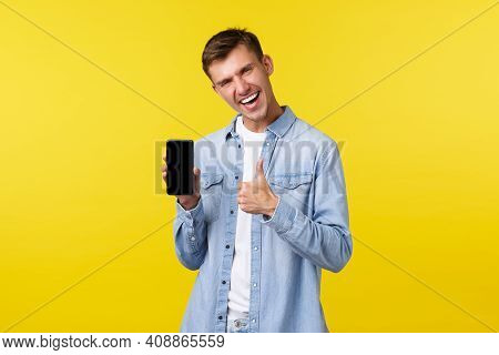 Leisure, Technology And Application Advertisement Concept. Joyful Enthusiastic Handsome Guy Showing