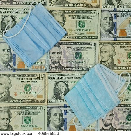 Disposable Face Masks And Background With American Dollar Bills, View From Above
