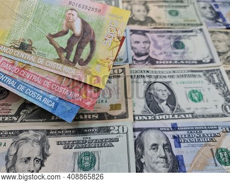 Approach To Costa Rica Banknotes And Background With American Dollar Bills