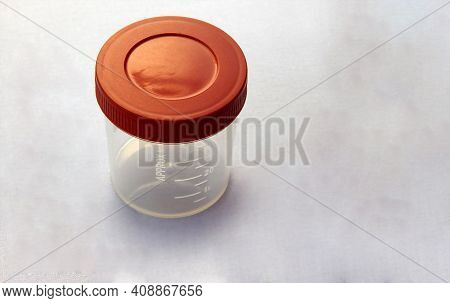 Close-up View Of  Empty Plastic Container For Taking Urine Samples Of Patient In Pathology Laborator