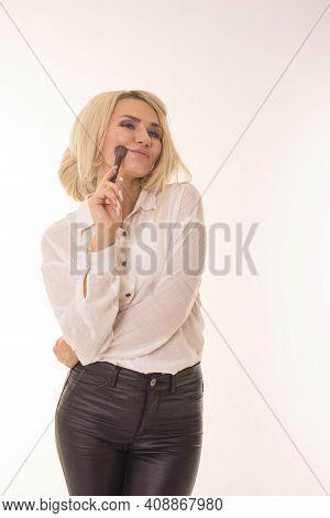 Cute Girl With Makeup Brush In Studio.