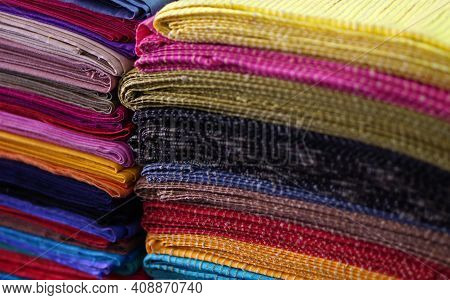 Close-up View Of Indian Hand Loom Woven Bed Sheets Stacked Retail Display In The Market