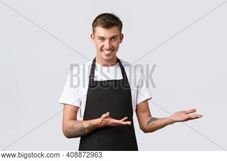 Cafe And Restaurants, Coffee Shop Owners And Retail Concept. Handsome Salesman, Waiter In Black Apro