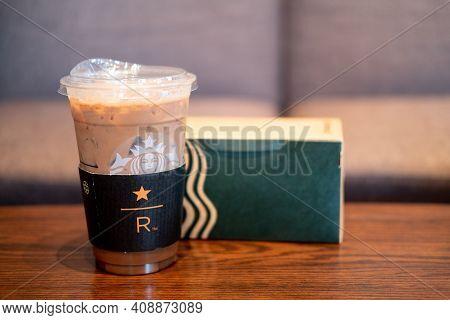 Samut Prakan, Thailand - February 19, 2021 : Starbucks Iced Mocha Coffee And Cake In Box Takeaway On