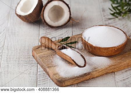 Sugar Substitute In A Wooden Bowl On A Background Of Coconut. Natural Sweetener. Stevia, Erythritol.