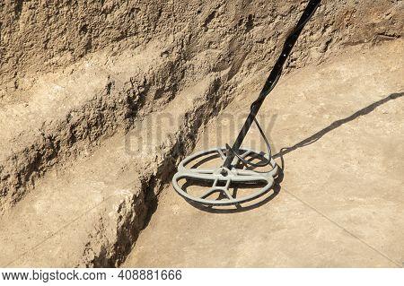 Archaeological Excavation. Metal Detector. Man With Metal Detector, Looking For Archaeological Treas