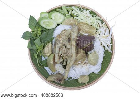Top View Of Rice Vermicelli With Green Curry Chicken And Vegetable In Wooden Plate Isolated On White