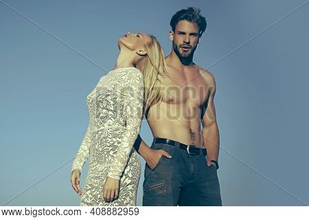 Couple In Love On Blue Sky. Fashion And Beauty. Relationship, Heterosexual And Lifestyle Concept, Co