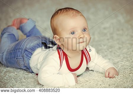 Infancy, Newborn. Infant Crawl On Floor Carpet. Child Development Concept. Baby With Blue Eyes On Ad