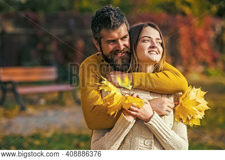 Couple In Love In Autumn Park. Nature Fall. Man And Woman With Yellow Tree Leaves. Autumn Happy Coup