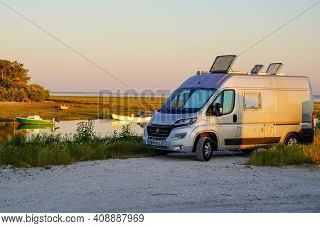 Ares, Aquitaine  France - 02 16 2021 : Fiat Ducato Campereve In Sunset Holidays Motorhome And Camper