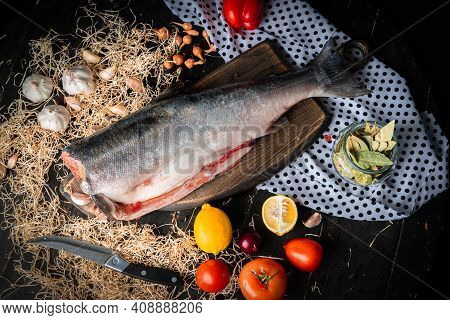 Raw Headless Coho Salmon With Lemons And Vegetables