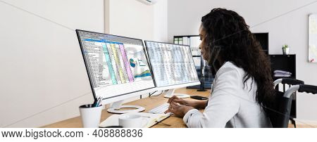 Business Data Analyst Working With Spreadsheet On Computer