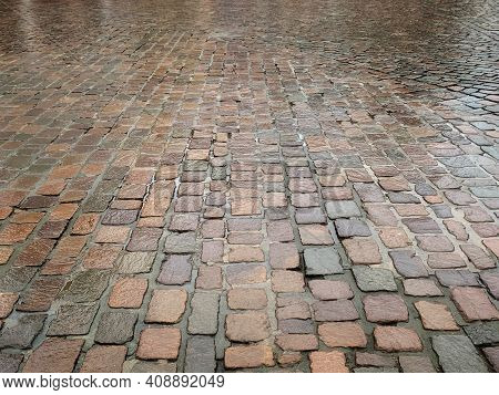 Wet Cobble Stone Pavement Made Of Square Granite Blocks On A Rainy Day, Very Clean