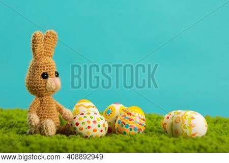Easter background with cracked eggs green grass blue sky and easter bunny