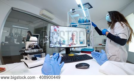 Pov Of Scientist Listening Professional Doctor On Video Call, Discussing During Virtual Meeting In M