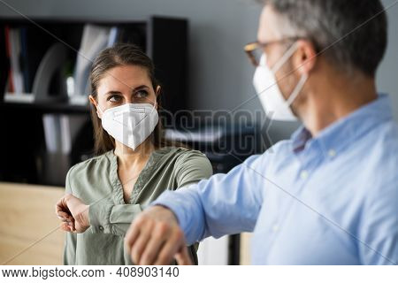 Employee Social Distancing Elbow Bump Wearing Covid Face Mask